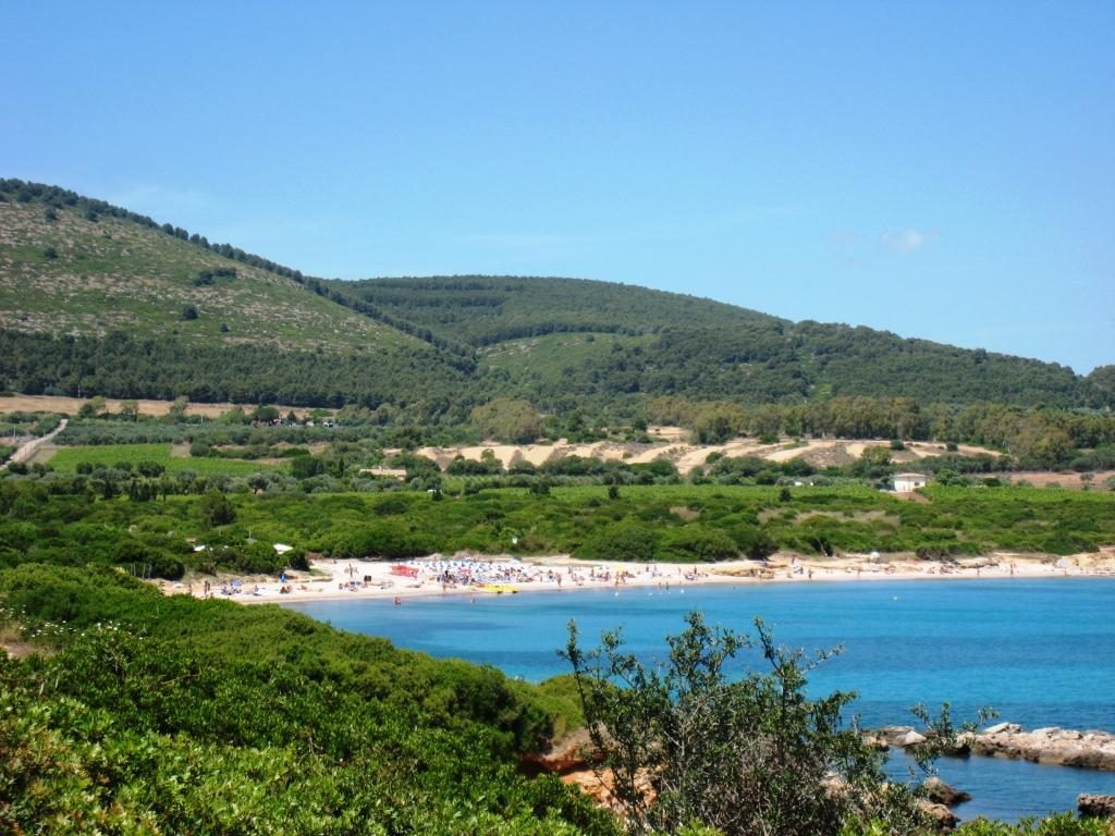 En av Sardinias vakre strender utenfor Alghero